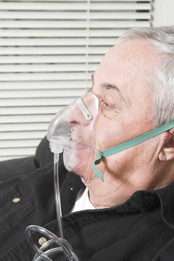 Senior with oxygen mask royalty free stock photo