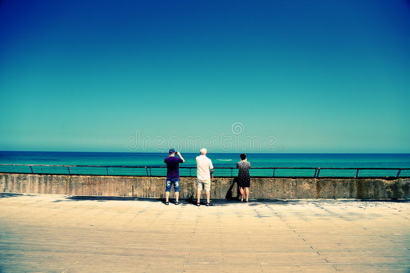 Senior parents with adult son. Traveling together royalty free stock images