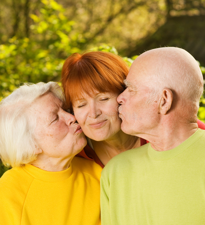 Download Senior Parents Kissing Their Daughter Stock Photography - Image: 5609012