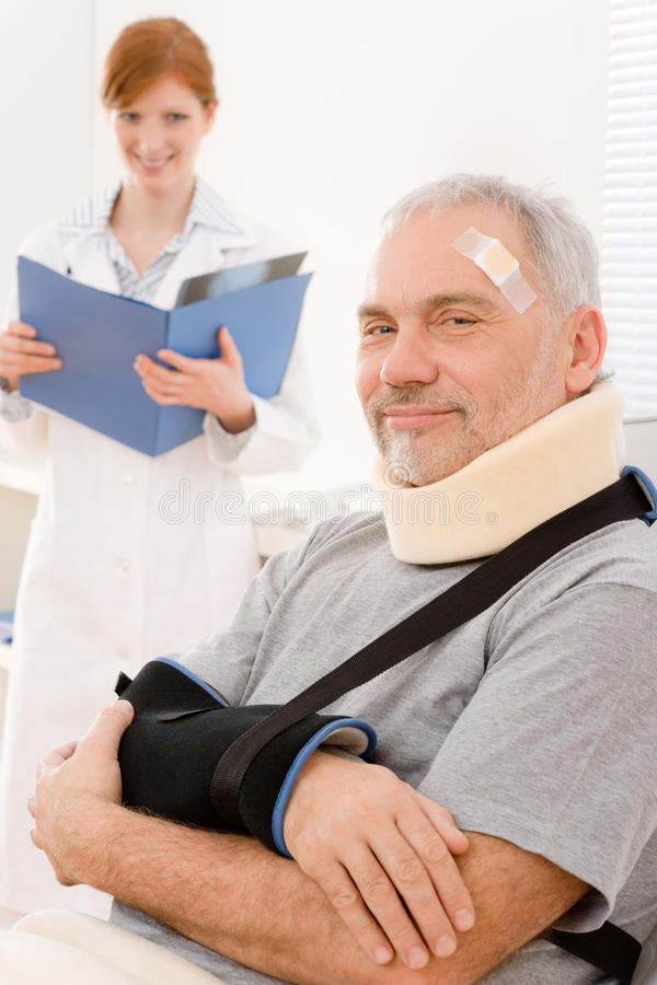 Senior patient broken arm in doctor office royalty free stock photo