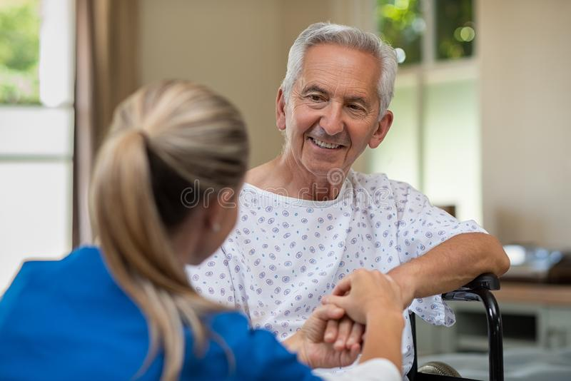 Senior patient with doctor stock image