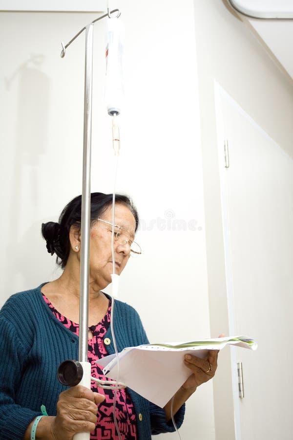 Senior patient read health laboratory result stock image