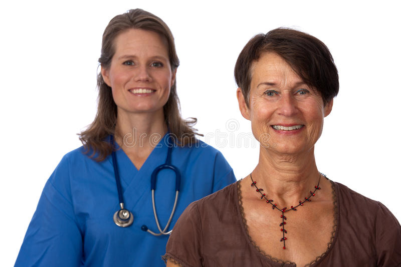 Senior patient with young doctor in backgrou stock photos