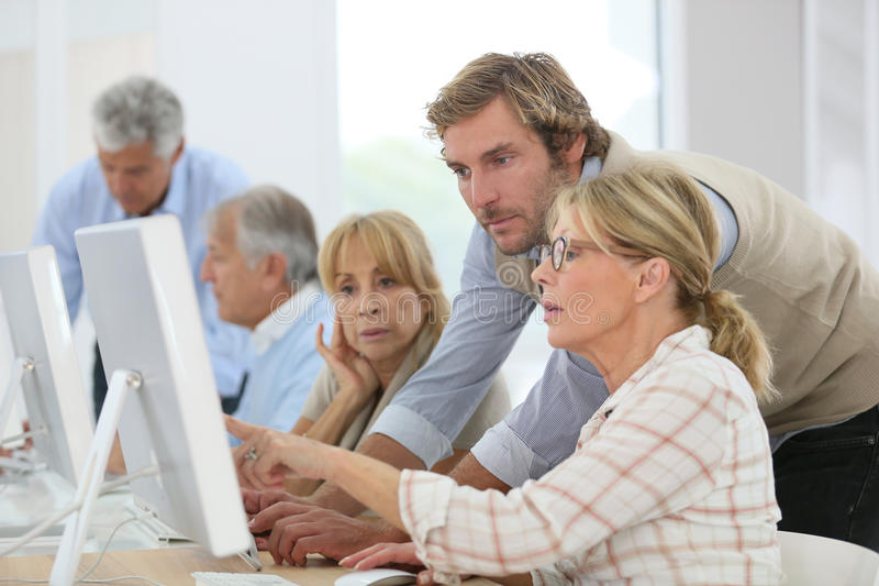 Senior people attending computing class royalty free stock photos