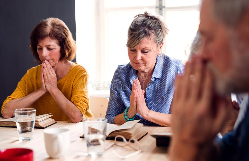 Senior people in bible reading group in community center club. royalty free stock photography