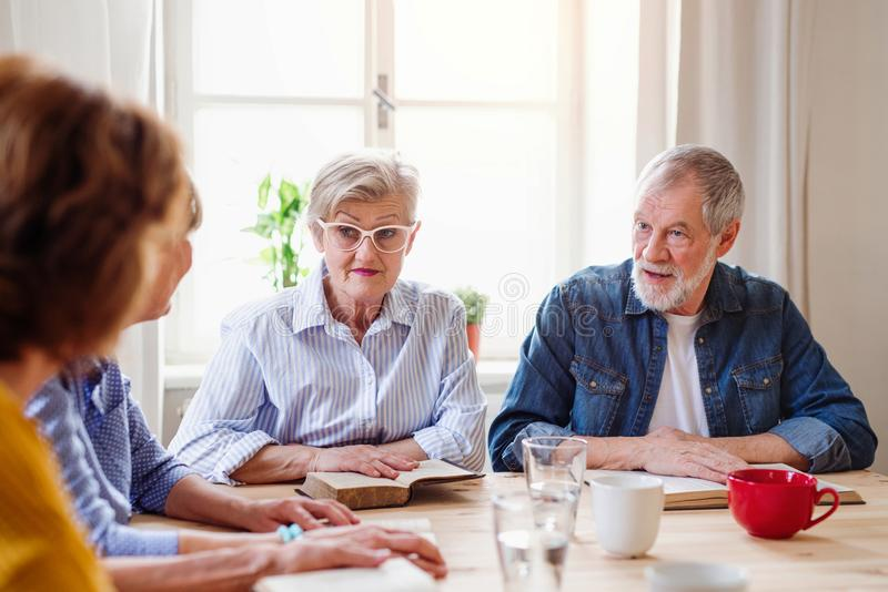 Senior people in bible reading group in community center club. royalty free stock image