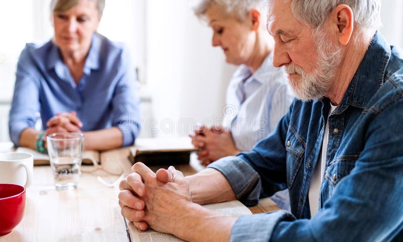 Senior people in bible reading group in community center club. stock photos