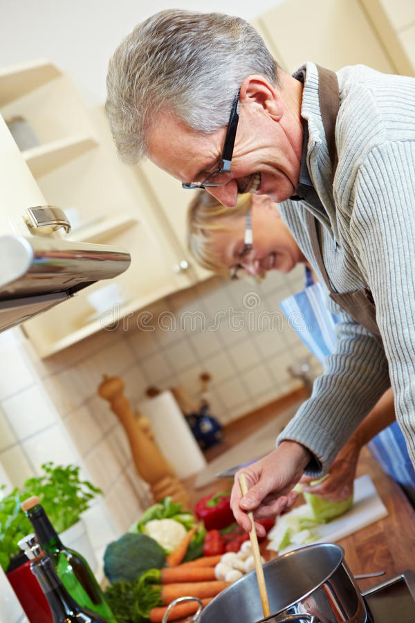 Senior people cooking stock image