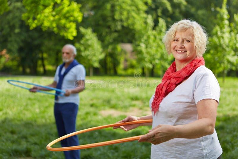 Senior people doing fitness training in garden stock image