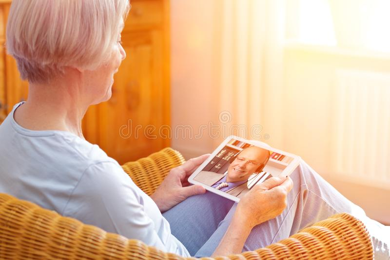 Senior woman tablet computer e-learning royalty free stock photography