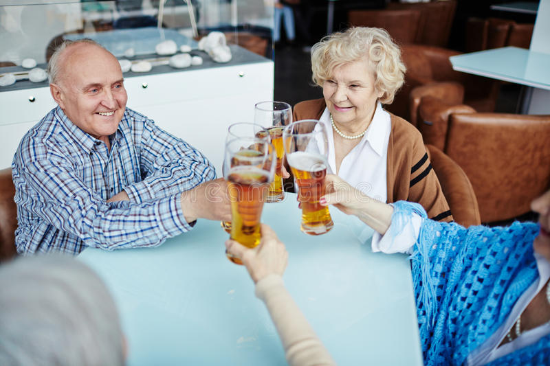 Senior people gathered in pub royalty free stock photography