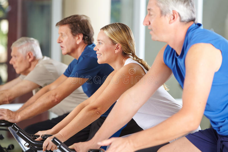 Senior people group in spinning class in gym royalty free stock photo