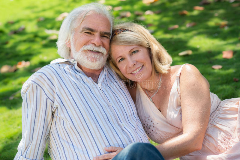 Senior People In Love With Man And Woman Hugging Royalty Free Stock Photo