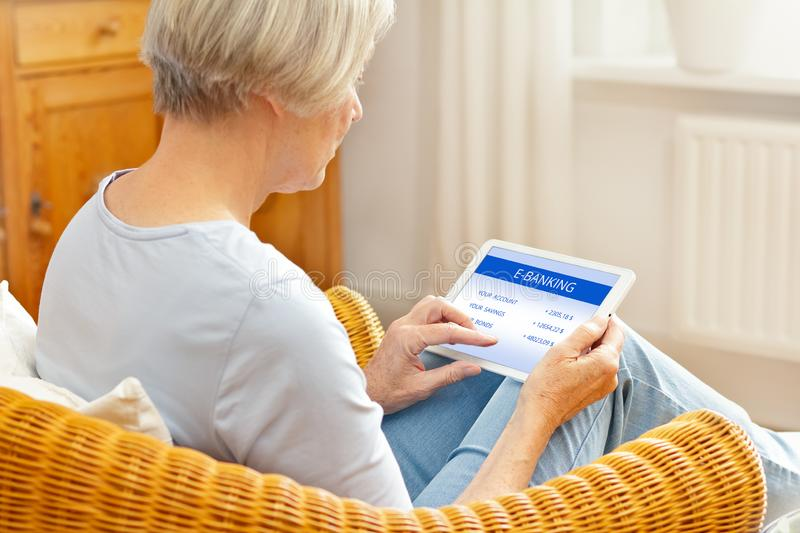 Woman tablet computer online banking royalty free stock photo