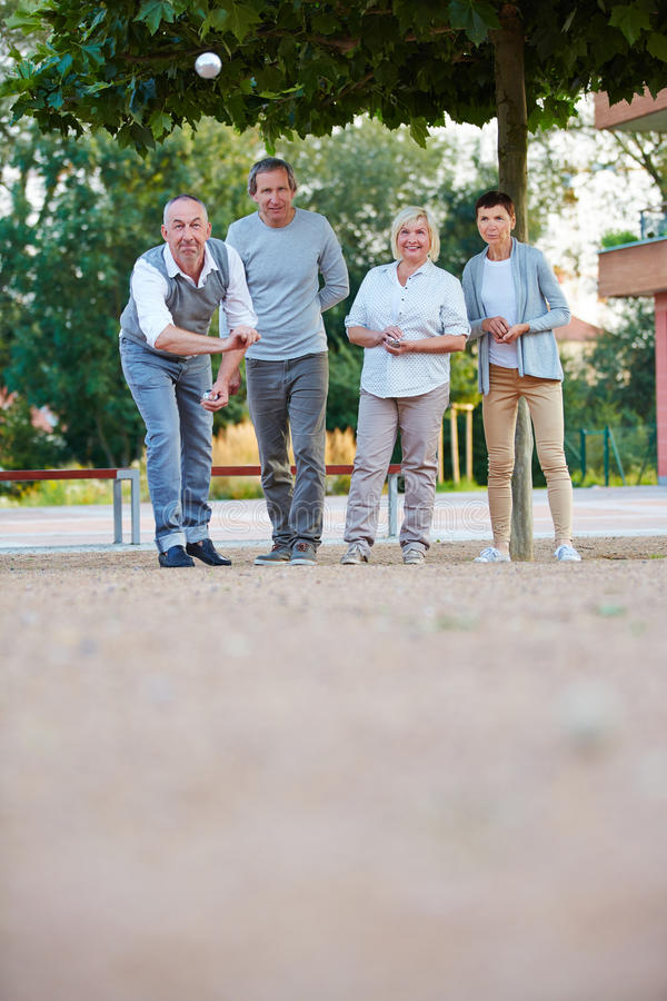 Senior people playing boule together stock images