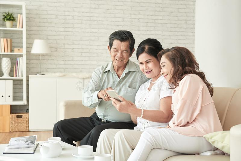 Senior people resting at home stock image