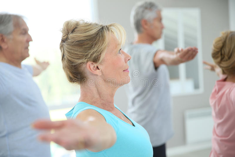 Senior people stretching and feeling relaxed stock photo