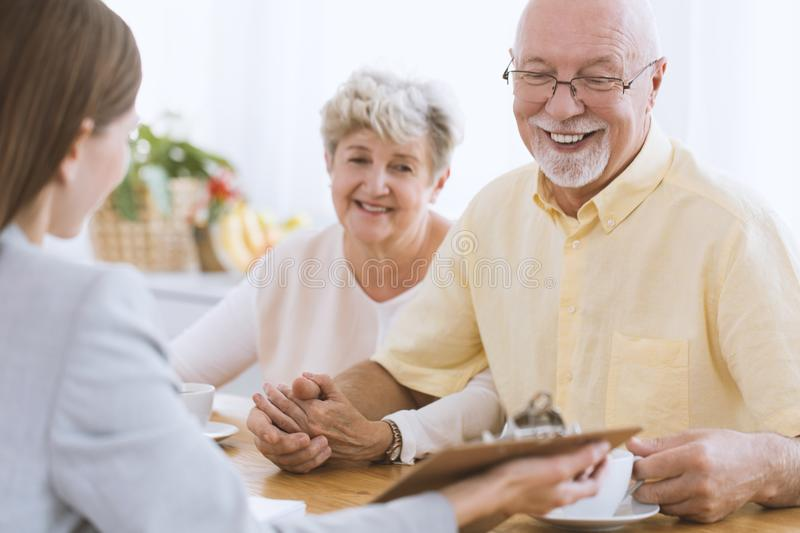 Senior people and financial advisor royalty free stock photo