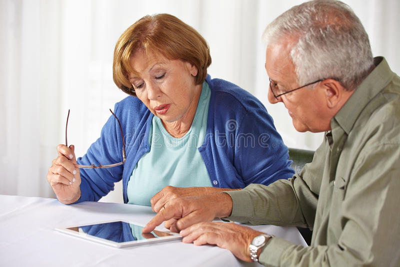 Senior people testing tablet PC royalty free stock images