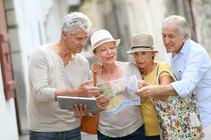 Senior people on a trip visiting monuments royalty free stock photography