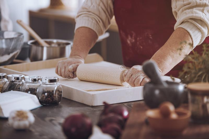 Download Senior Person Rolling Out Dough Stock Image - Image of pizza, rolling: 104300885