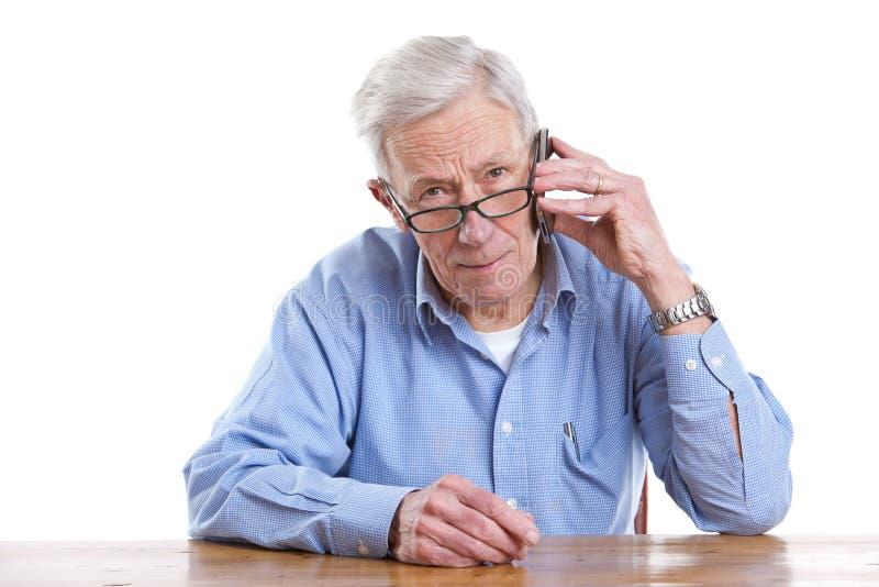Senior on the phone stock image