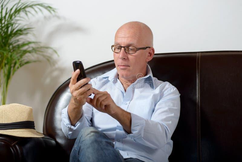 A senior phone royalty free stock image