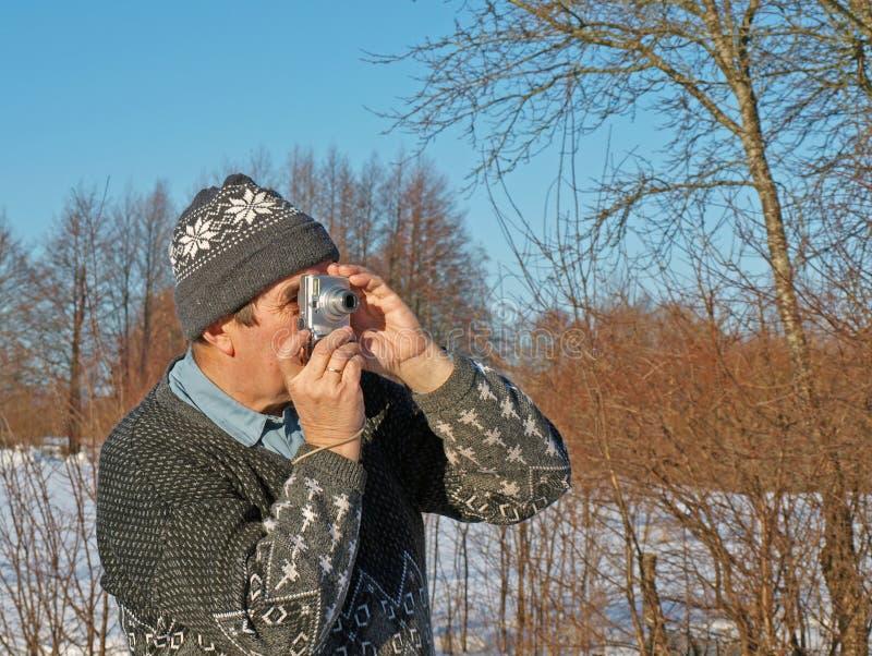 Senior photographer amateur 3. Senior man taking photos with cheap camera stock image