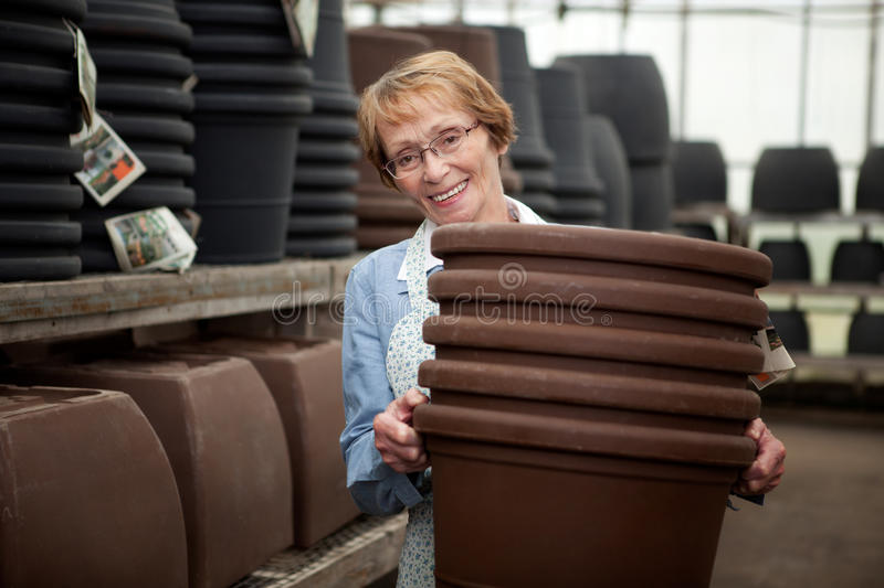 Senior With Plant Pots royalty free stock image