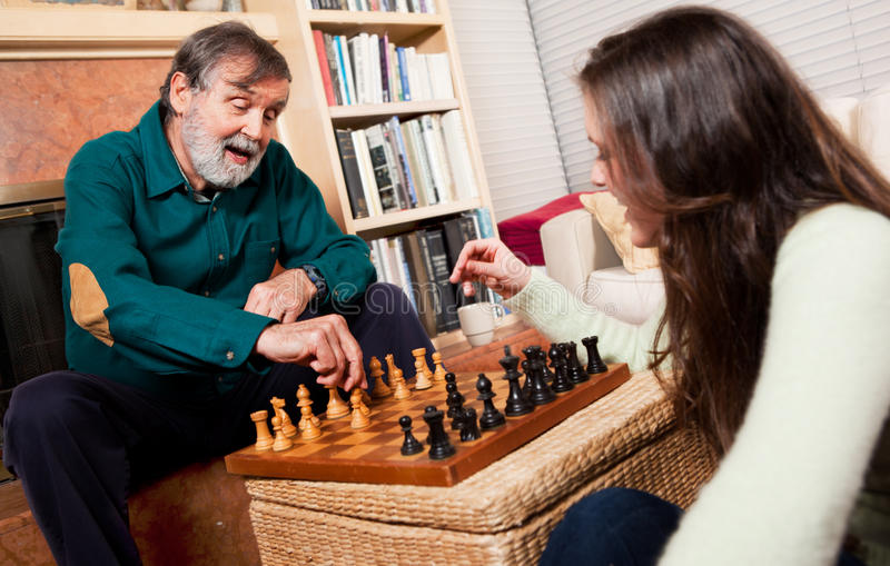 Senior playing chess stock images