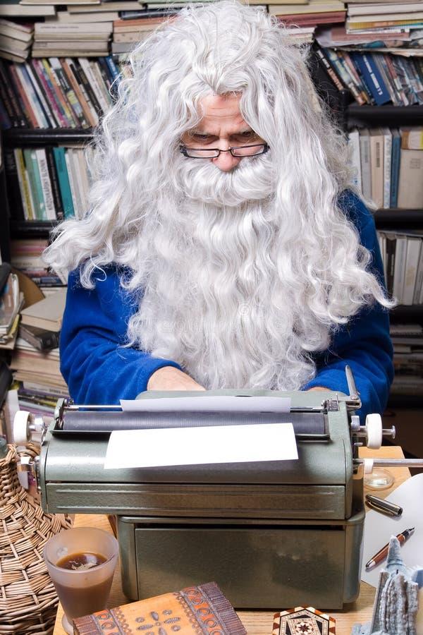Senior poet. Author working on a old typewriter stock image