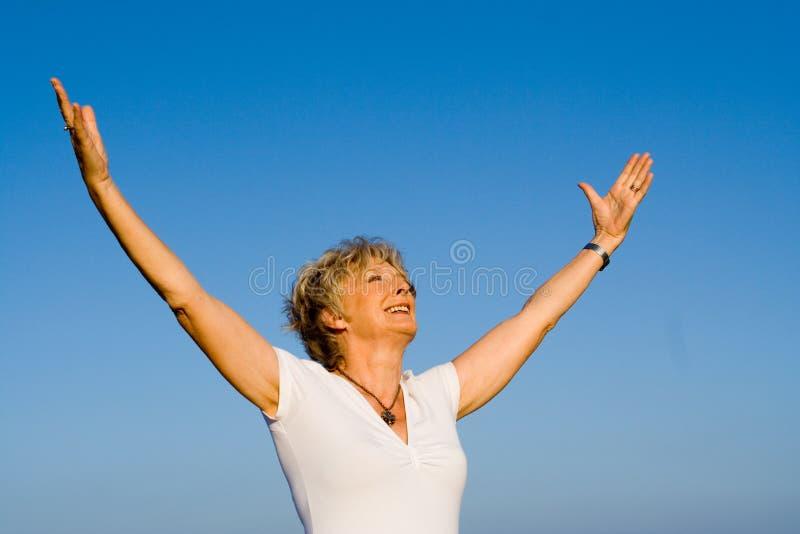 Senior praise stock photo