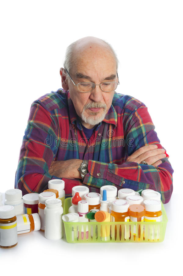 Senior with prescription bottles royalty free stock photography