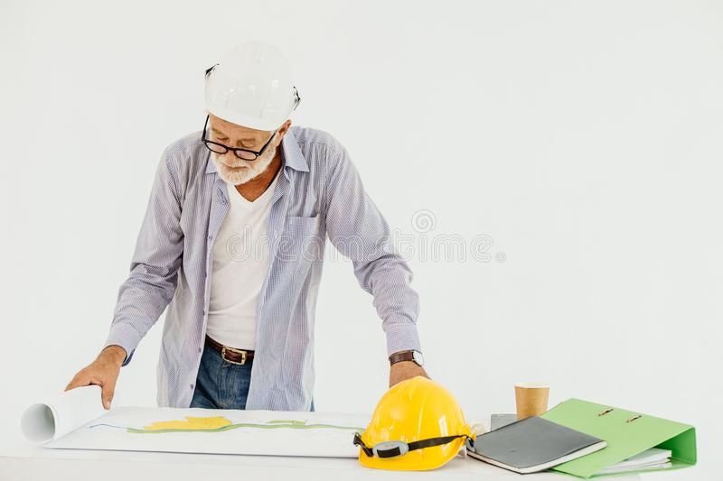 Senior professional architecture building engineer looking at blueprint floor plan serious working royalty free stock photography