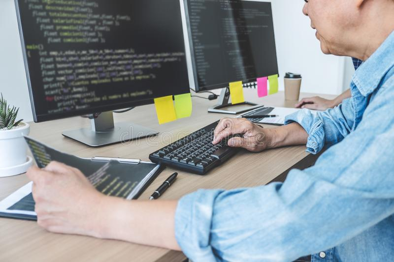 Senior Professional programmer working at developing programming and website working in a software develop company office, writing royalty free stock image