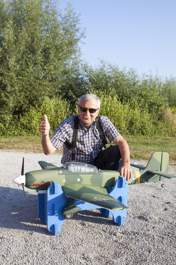 Download Senior RC Modeller And His New Plane Model Stock Image - Image: 33028713