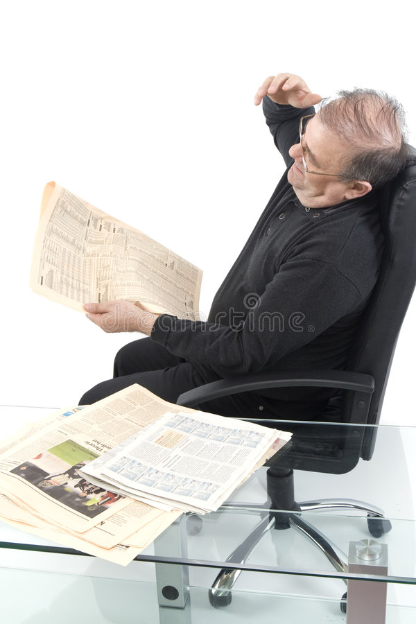 Senior read newspaper stock images