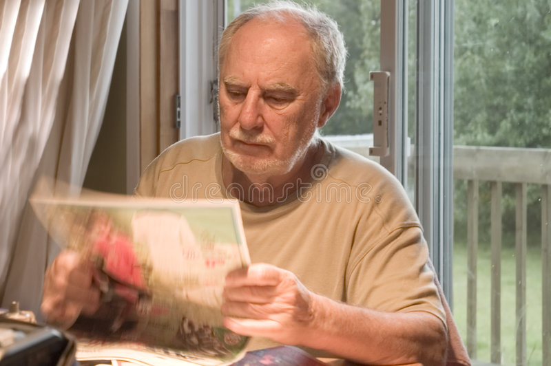 Senior reading royalty free stock images