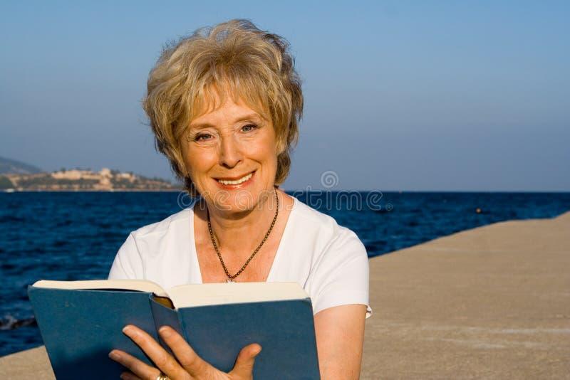 Senior reading stock photography