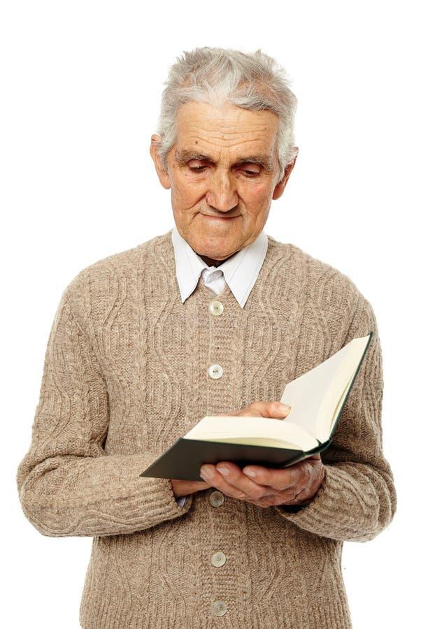 Senior reading a book royalty free stock photos