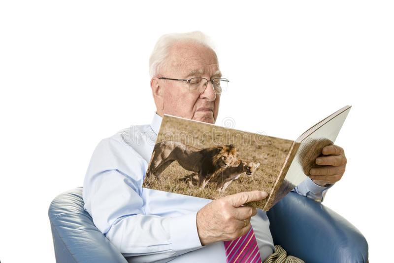 Senior reading a picture book stock photo