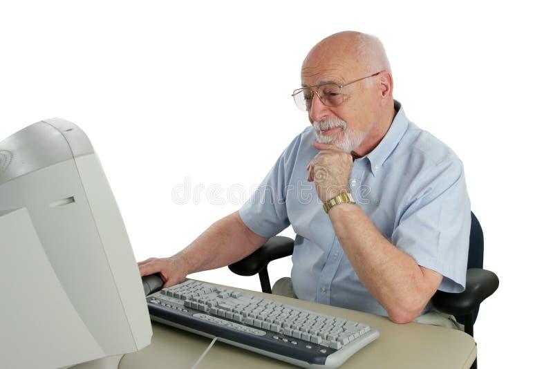 Senior Researching Online stock photos
