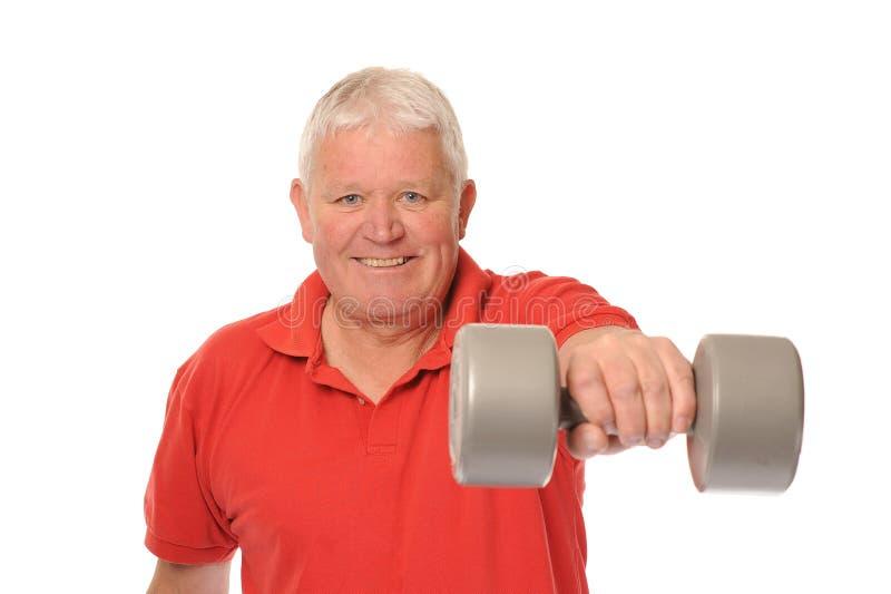 Senior retired man exercising royalty free stock photos