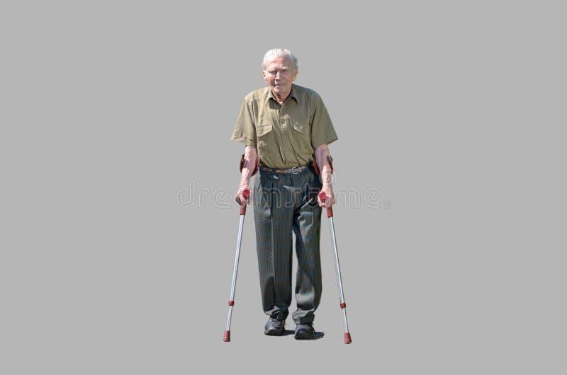 Senior retired man walking on crutches stock images