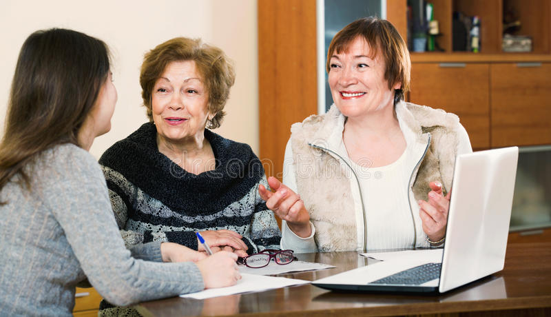 Senior satisfied women making will at public notary office royalty free stock images