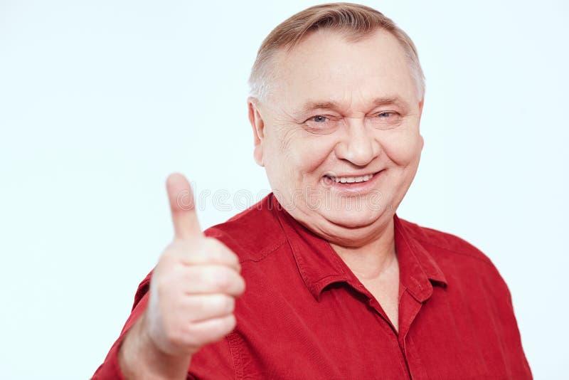 Senior showing thumb up sign stock image