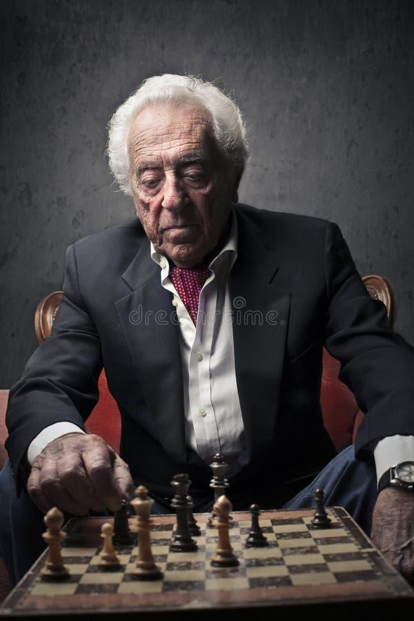 Senior Sitting On An Armchair Royalty Free Stock Photos