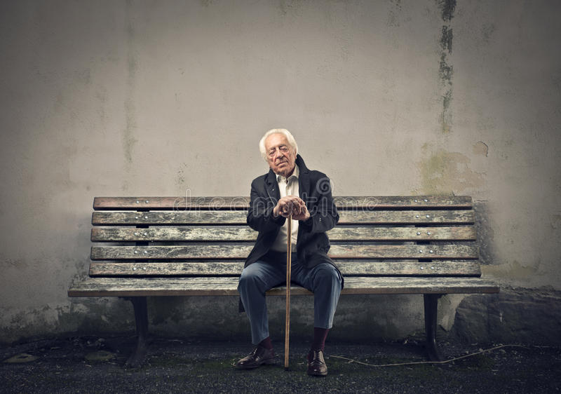 Senior sitting on a bench stock images