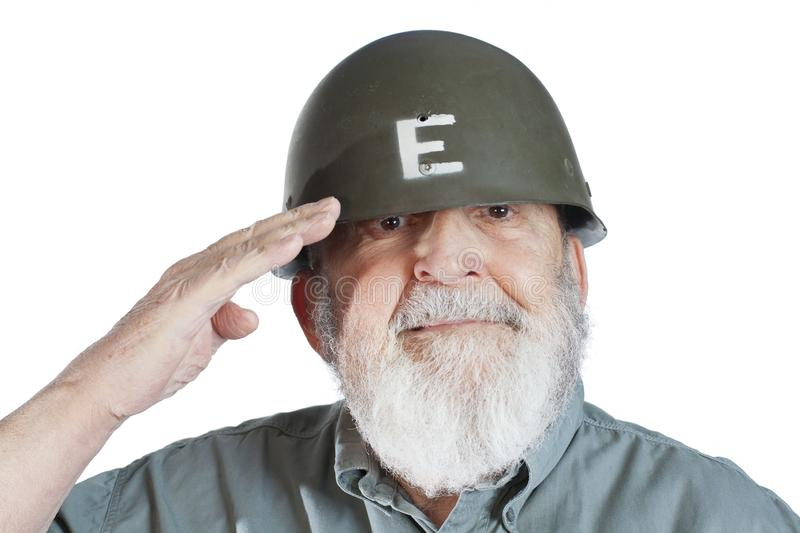Senior soldier veteran saluting isolated on white background. Elderly soldier veteran saluting stock photography