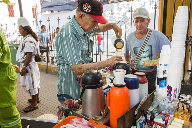 Senior street vendor selling coffee called Tinto in Plaza De Bolivar, Cartagena. stock photos